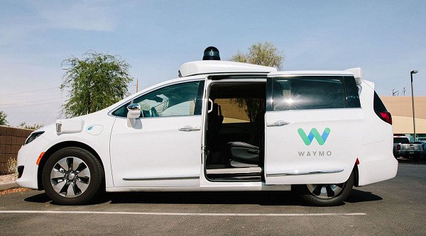 A Waymo Chrysler Pacifica autonomous vehicle sits parked in Chandler, Ariz., in July 2018.